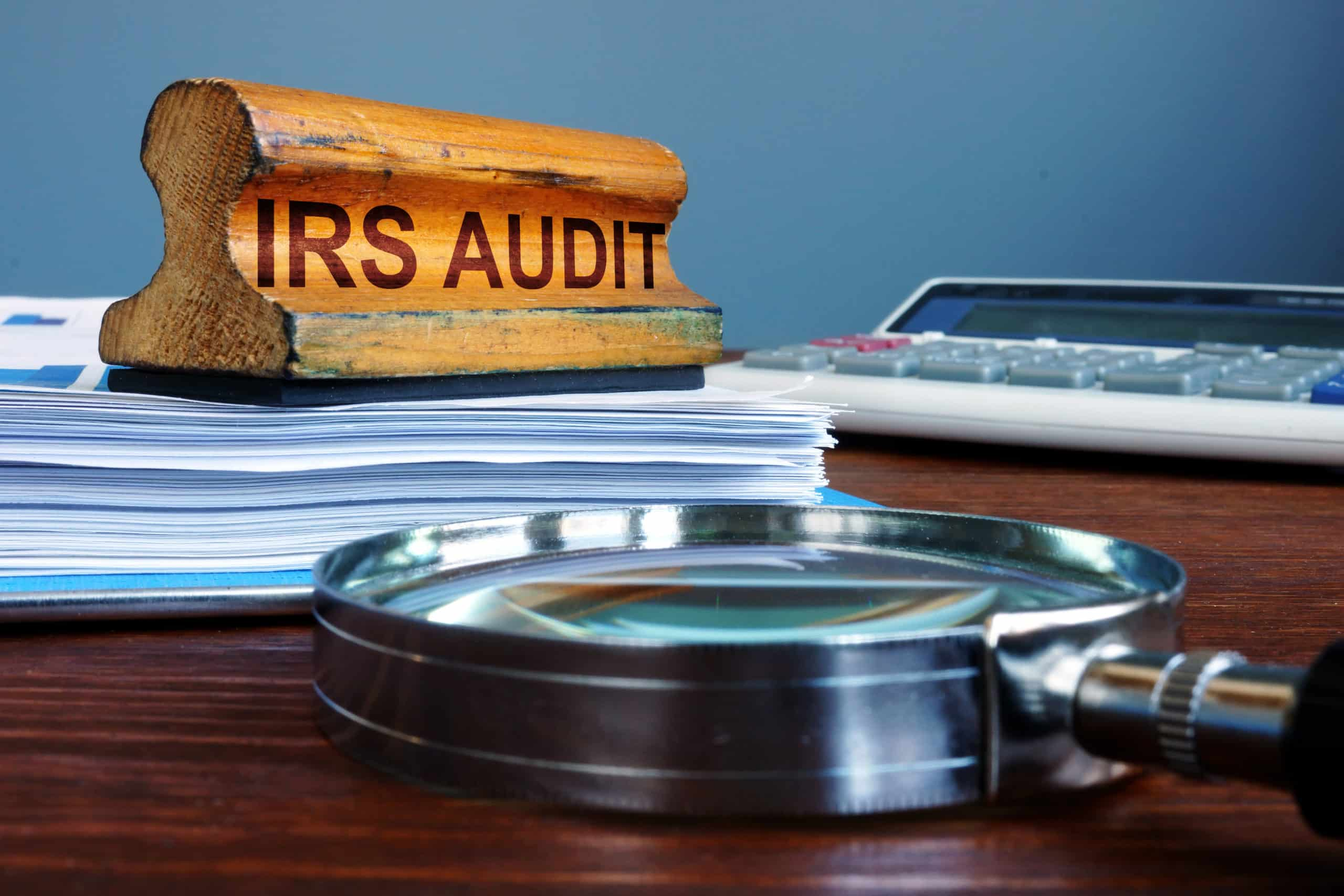 IRS audit stamp and accounting documents for a cannabis business